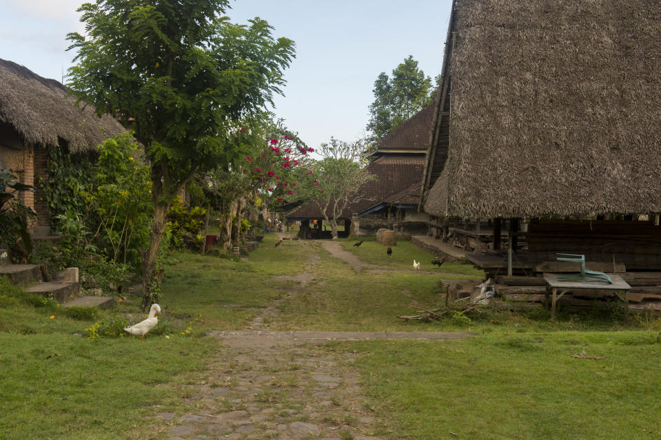 INDONESIA - 2019/05/23: The Tenganan Village in East Bali, Indonesia, retains much of its traditional layout and architecture with houses built on both sides of the open space in the center. (Photo by Wolfgang Kaehler/LightRocket via Getty Images)