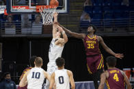 Penn State forward John Harrar (21) lays up the ball while Minnesota forward Isaiah Ihnen (35) defends during an NCAA college basketball game Wednesday, March 3, 2021, in State College, Pa. (Noah Riffe/Centre Daily Times via AP)