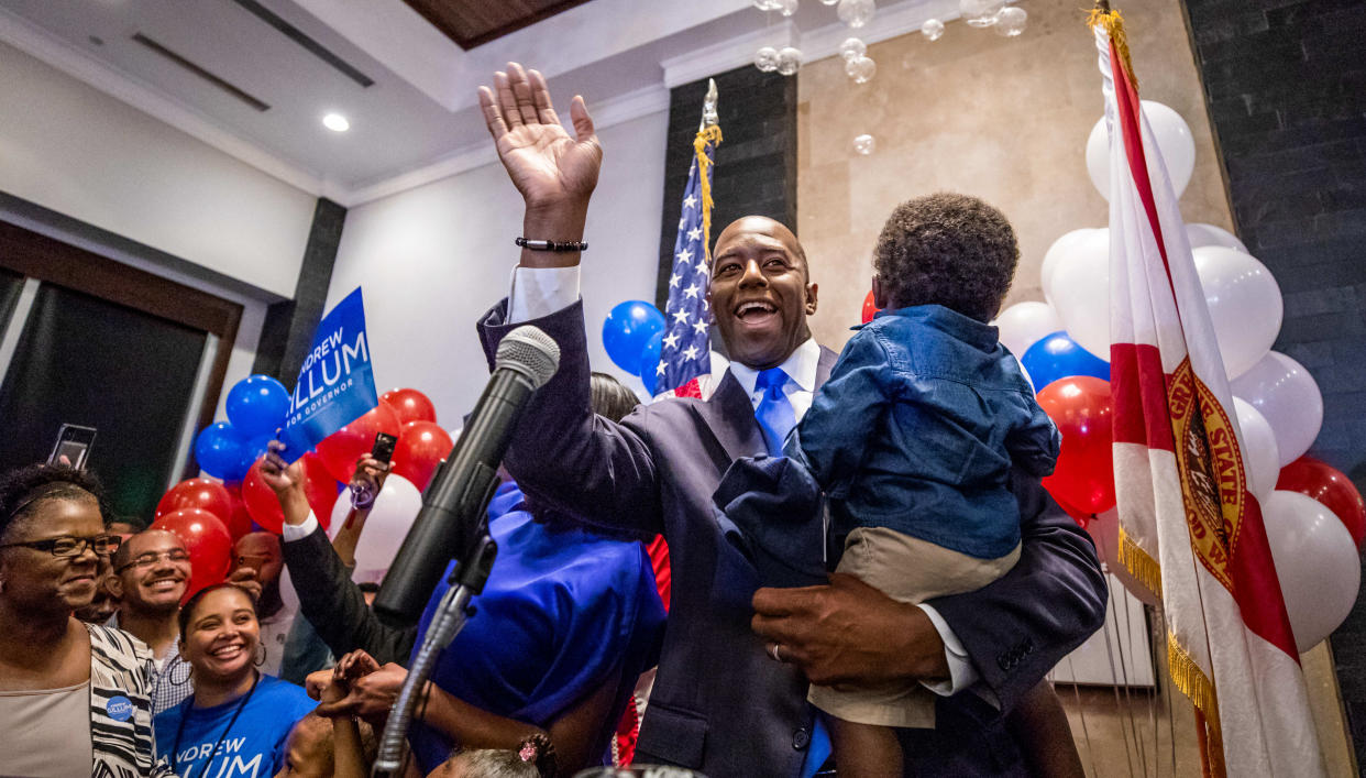 Andrew Gillum, holding son Davis, celebrates winning the Democratic primary for governor Tuesday night in Tallahassee, Fla. (Photo: Colin Hackley/Tampa Bay Times via Zuma Wire)