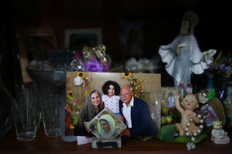 A photograph shows a missing silo employee Ghassan Hasrouty posing with his family, in the family home following Tuesday's blast in Beirut's port