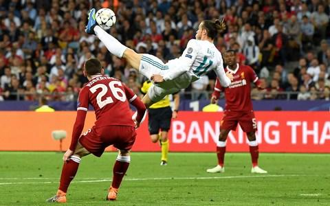 Gareth Bale of Real Madrid shoots and scores his side's second goal during the UEFA Champions League Final - Credit: Getty Images