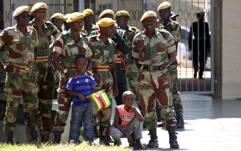 Zimbabwean security forces and two children attend Zimbabwe's 33rd independence celebrations in Harare, Thursday, April, 18, 2013. (AP Photo/Tsvangirayi Mukwazhi)