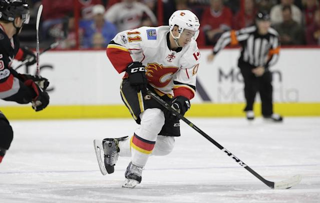 "<a class=""link rapid-noclick-resp"" href=""/nhl/teams/cgy/"" data-ylk=""slk:Calgary Flames"">Calgary Flames</a>' <a class=""link rapid-noclick-resp"" href=""/nhl/players/4263/"" data-ylk=""slk:Mikael Backlund"">Mikael Backlund</a> (11) skates against the <a class=""link rapid-noclick-resp"" href=""/nhl/teams/car/"" data-ylk=""slk:Carolina Hurricanes"">Carolina Hurricanes</a> during the first period of an NHL hockey game in Raleigh, N.C., Sunday, Feb. 26, 2017. (AP Photo/Gerry Broome)"