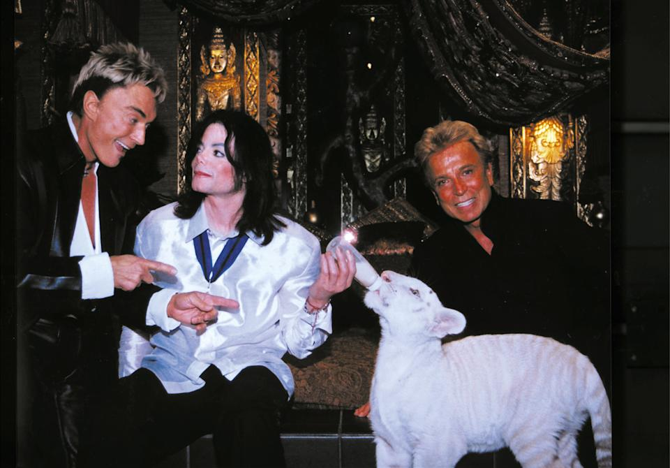 Siegfried & Roy pose with singer Michael Jackson and Apollo, a rare white Siberian tiger backstage at The Mirage on August 6, 2002 in Las Vegas. (Photo courtesy of Siegfried & Roy/The Mirage via Getty Images)