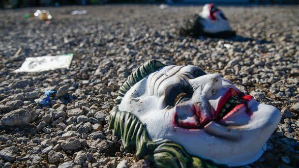 PHOTO: Halloween masks litter the ground amongst signs of chaos at the scene of a deadly shooting in Greenville, Texas, on Oct. 27, 2019. (Ryan Michalesko/The Dallas Morning News via AP)