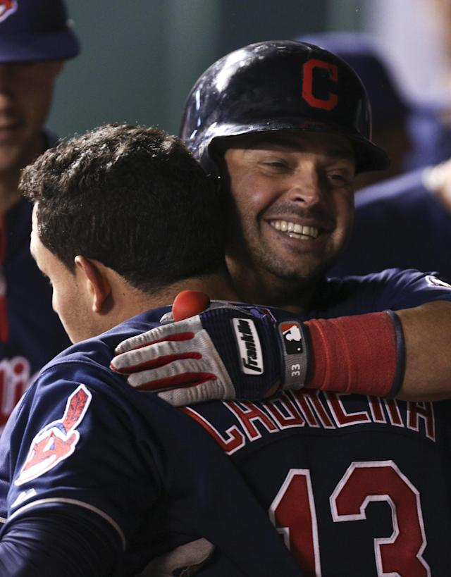 KANSAS CITY, MO - APRIL 28: Nick Swisher #33 of the Cleveland Indians hugs Asdrubal Cabrera #13 after Swisher's sacrifice fly scored Cabrera in the eighth inning during game two of a doubleheader against the Kansas City Royals at Kauffman Stadium on April 28, 2013 in Kansas City, Missouri. (Photo by Ed Zurga/Getty Images)