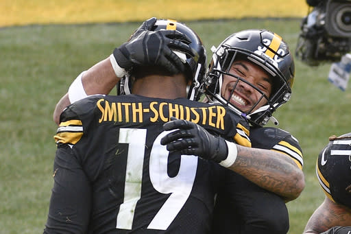 Pittsburgh Steelers wide receiver JuJu Smith-Schuster (19) celebrates with running back James Conner (30) after making a touchdown catch against the Indianapolis Colts during the second half of an NFL football game, Sunday, Dec. 27, 2020, in Pittsburgh. (AP Photo/Don Wright)
