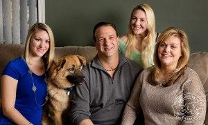The Cuccio family, from left: Casey, Rob, Samantha and Cheryl at their home. (Their dog's name is Brody.)