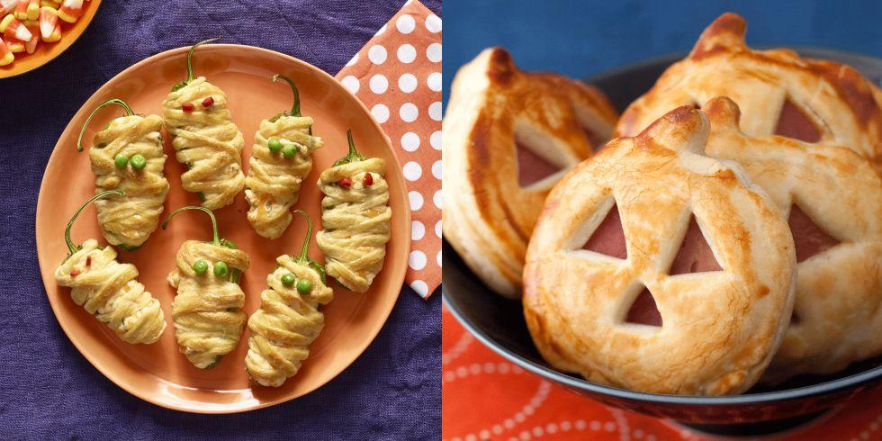 """<p>Create a supernatural spread with these easy Halloween-themed finger foods that both kids and adults will love. And if you're in charge of hosting a Halloween dinner this year, it would be <em>ghoulish</em> of you not to check out our favorite <a rel=""""nofollow"""" href=""""https://www.womansday.com/food-recipes/g2575/halloween-dinner-ideas/"""">Halloween dinner recipes</a>. </p>"""