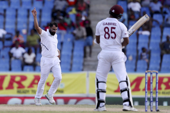India's Mohammed Shami celebrates taking the wicket of West Indies' Shannon Gabriel during day four of the first Test cricket match at the Sir Vivian Richards cricket ground in North Sound, Antigua and Barbuda, Sunday, Aug. 25, 2019. (AP Photo/Ricardo Mazalan)