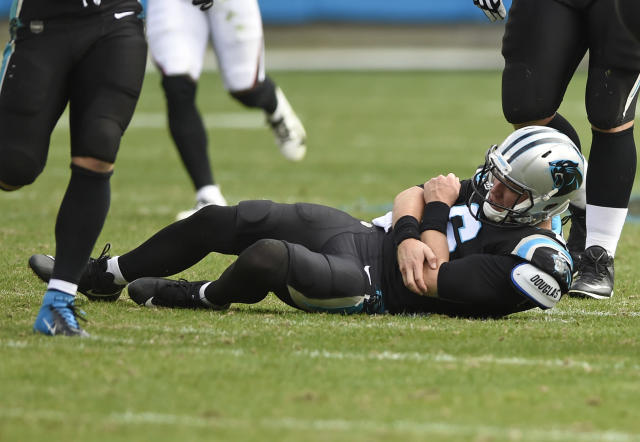 Carolina Panthers' Taylor Heinicke (6) holds his arm after being injured against the Atlanta Falcons during the first half of an NFL football game in Charlotte, N.C., Sunday, Dec. 23, 2018. (AP Photo/Mike McCarn)
