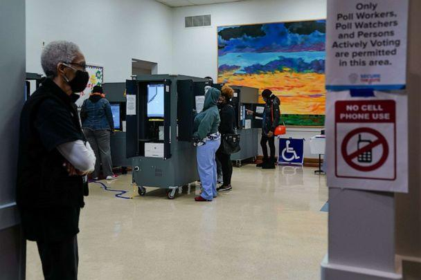 PHOTO: Voters wearing protective masks cast ballots at a polling location for the 2020 Presidential election in College Park, Ga., Nov. 3, 2020. (Bloomberg via Getty Images, FILES)