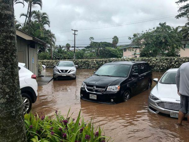 PHOTO: Water floods a parking lot at a condo complex near Kahana Village in Lahaina, Hawaii, Sept. 12, 2018. (Lauren Greer/AP)