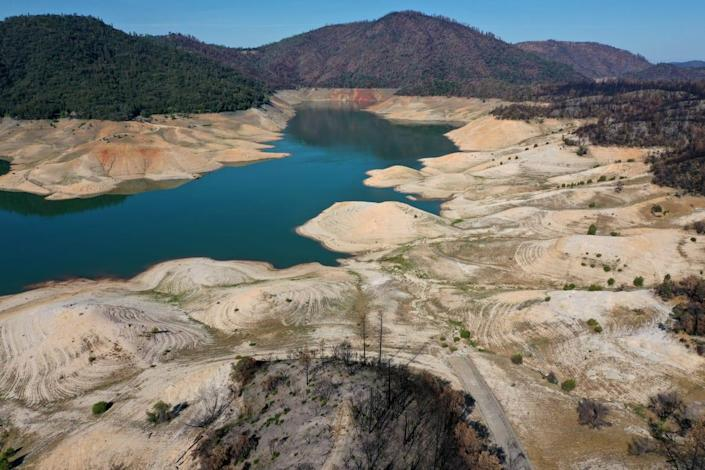 """<div class=""""inline-image__caption""""><p>Low water levels are visible at Lake Oroville on June 01, 2021 in Oroville, California. As the extreme drought takes hold in California, water levels at reservoirs are falling fast. Lake Oroville is currently at 38 percent of capacity. </p></div> <div class=""""inline-image__credit"""">Justin Sullivan/Getty</div>"""