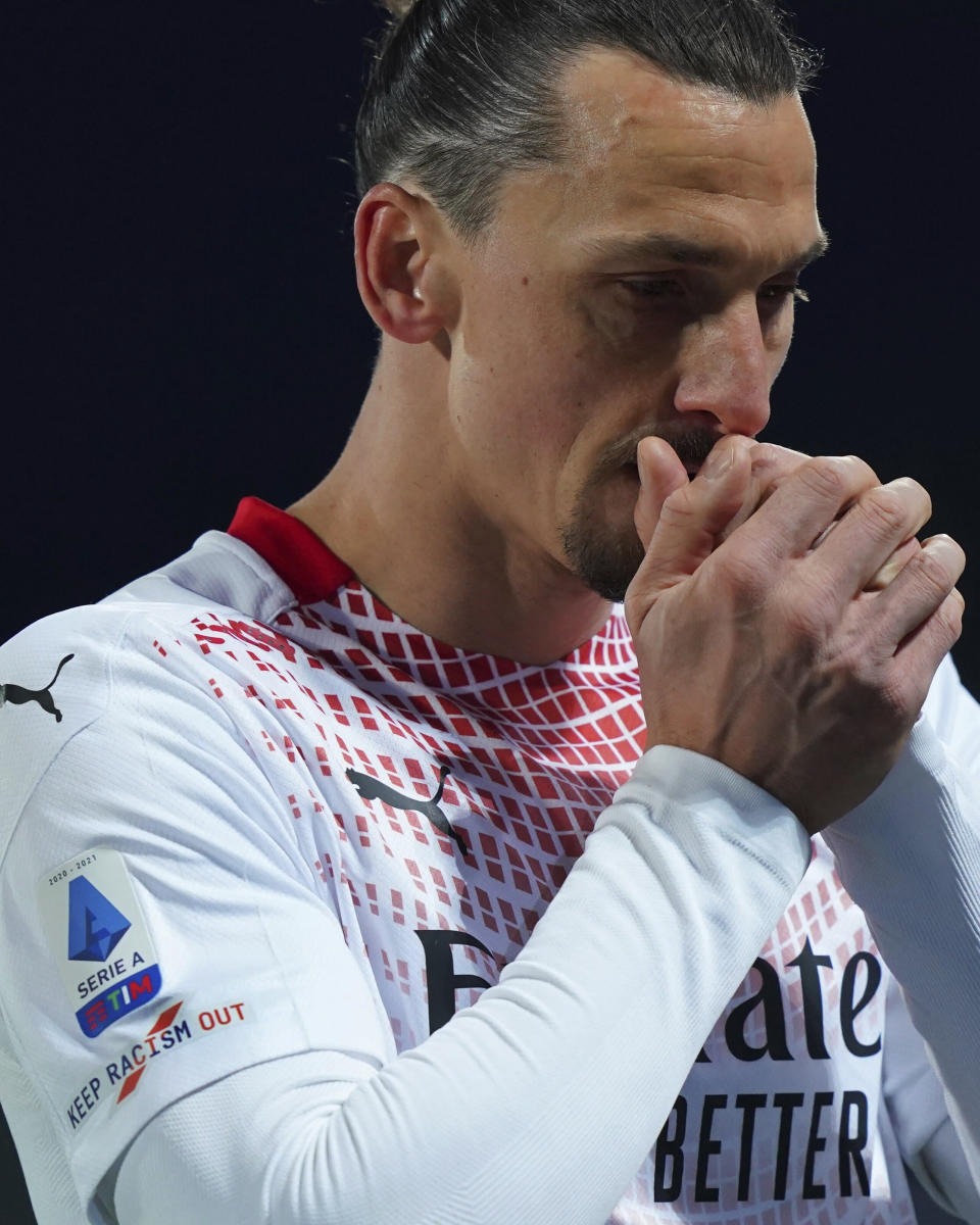 """AC Milan's Zlatan Ibrahimovic wears a jersey sporting a badge reading """"Keep racism out"""" as part of the new anti-racism campaign launched last Sunday by the Italian soccer League, during a Serie A match between Fiorentina and AC Milan at the Artemio Franchi stadium in Florence, Italy, Sunday, March 21, 2021. Serie A's efforts to combat racism inside its stadiums was in shambles little more than a year ago when league CEO Luigi De Siervo decided to take matters into his own hands. (Spada/LaPresse via AP)"""