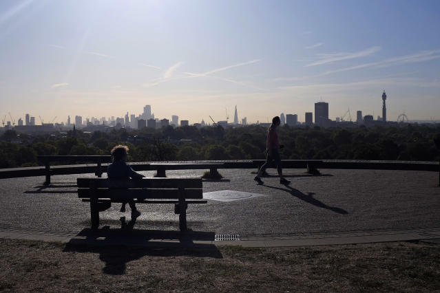 People walk to the top of Primrose Hill with the view of the London skyline, on Wednesday, Sept. 18, 2019. (AP Photo/Kiichiro Sato)