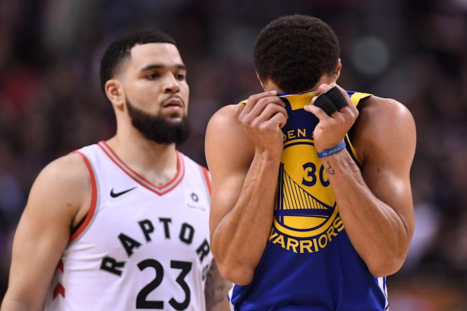 Golden State Warriors guard Stephen Curry (30) reacts in front of Toronto Raptors Fred VanVleet during the second half of Game 1 of basketball's NBA Finals, Thursday, May 30, 2019, in Toronto. (Frank Gunn/The Canadian Press via AP)