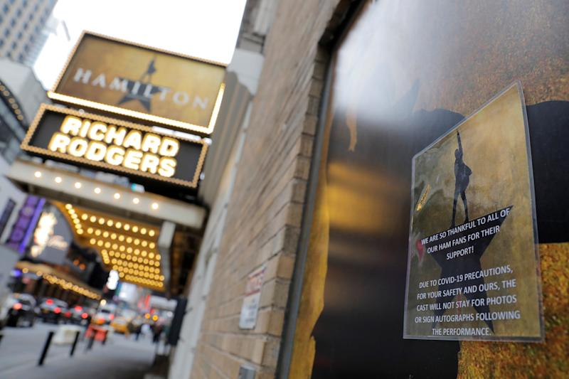 Signage regarding the coronavirus is seen on a doorway to the show Hamilton at the Richard Rodgers theater as Broadway shows announced they will cancel performances due to the coronavirus outbreak in Manhattan, New York City, New York, U.S., March 12, 2020. (Andrew Kelly/Reuters)