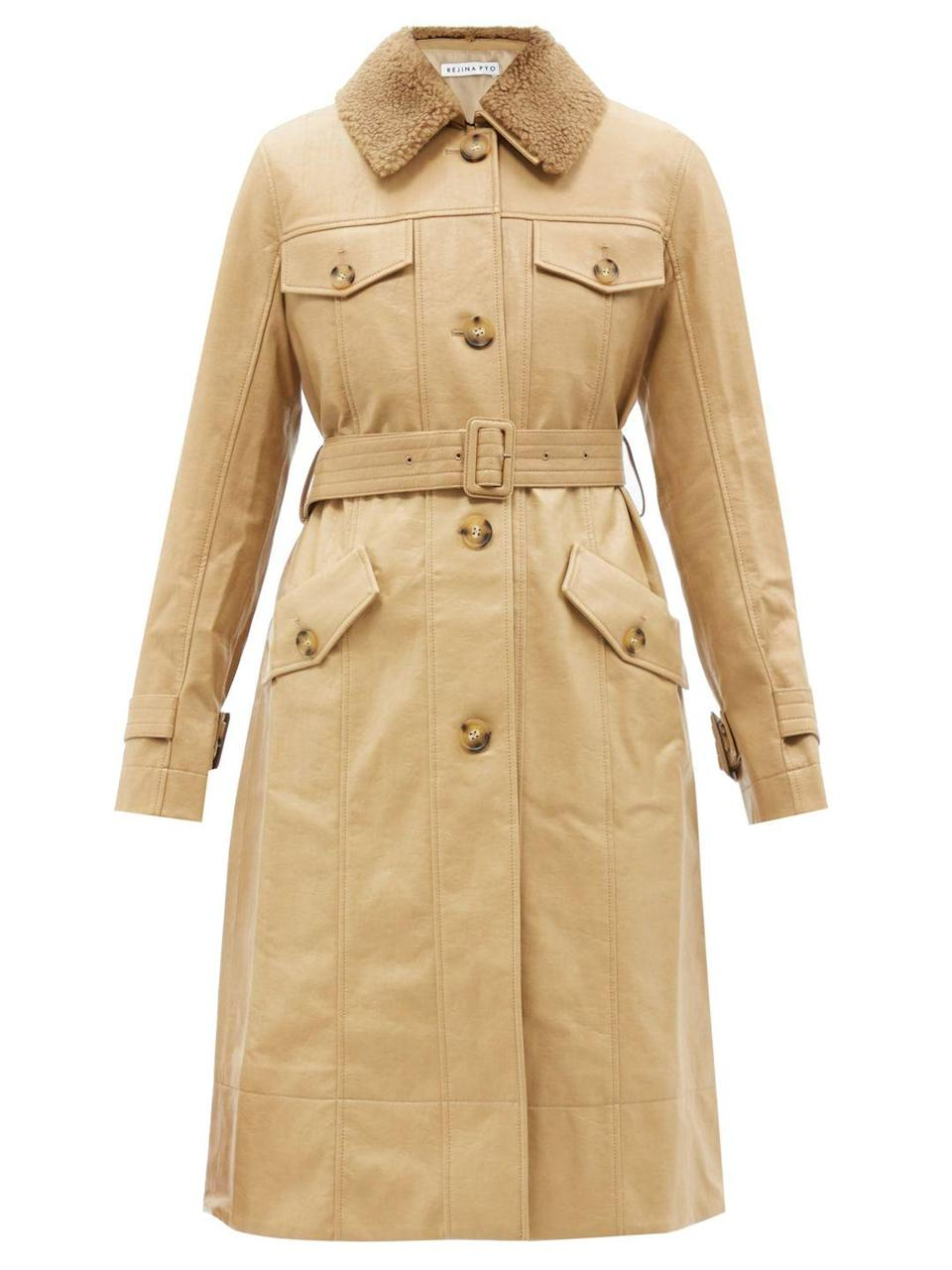 """<p><a class=""""link rapid-noclick-resp"""" href=""""https://www.matchesfashion.com/products/Rejina-Pyo-Hana-belted-faux-leather-coat-1432459"""" rel=""""nofollow noopener"""" target=""""_blank"""" data-ylk=""""slk:SHOP NOW"""">SHOP NOW</a></p><p>Fashion's obsession with leather is showing no signs of abating; so if you don't already have an A-line skirt or cropped trousers made of the stuff, you're missing a trick. Rejina Pyo's coat is proof that leather looks don't have to be dramatic or gothic, thanks to its 'Seventies-inspired belted shape, borg collar and tort buttons.</p><p>Hana Belted Faux-leather Coat, £795, Rejina Pyo</p>"""