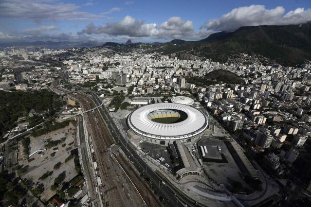 An aerial shot shows the Maracana stadium, one of the stadiums hosting the 2014 World Cup soccer matches, in Rio de Janeiro March 28, 2014. REUTERS/Ricardo Moraes (BRAZIL - Tags: SPORT SOCCER WORLD CUP CITYSCAPE)
