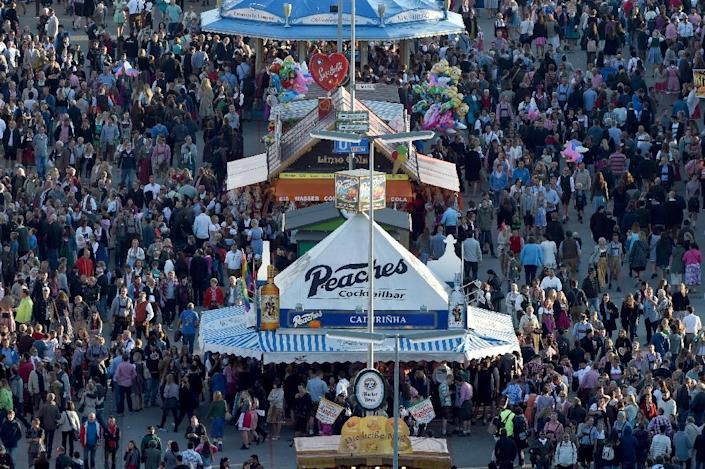 Visitors walk at the venue of the the annual Oktoberfest beer festival on October 02, 2015 in Muenchen (AFP Photo/Felix Horhager )