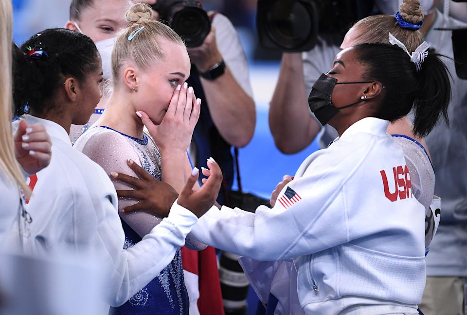 -TOKYO,JAPAN July 26, 2021: USAs Simone Biles and ROCs Angelina Melnikova embrace after the womens team final at the 2020 Tokyo Olympics.  (Wally Skalij /Los Angeles Times via Getty Images)