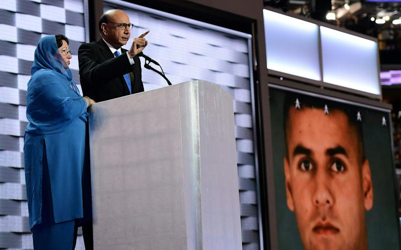 Khizr Khan in front of a photo of his son