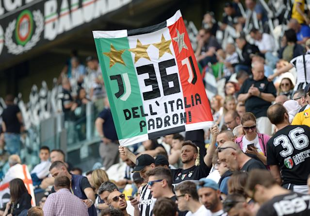 Soccer Football - Serie A - Juventus vs Hellas Verona - Allianz Stadium, Turin, Italy - May 19, 2018 Juventus fan dispays a banner before the match REUTERS/Massimo Pinca