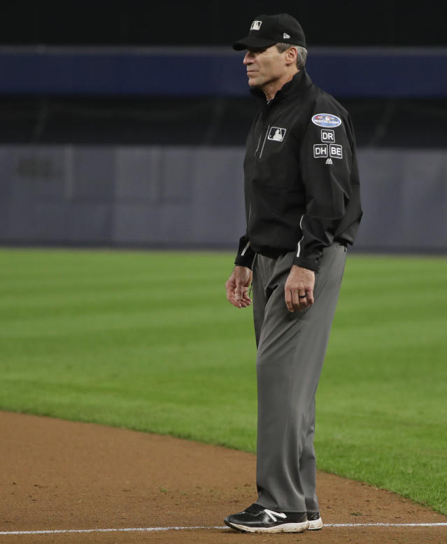 First base umpire Angel Hernandez (5) watches from his position during the second inning of Game 3 of baseball's American League Division Series between the New York Yankees and the Boston Red Sox, Monday, Oct. 8, 2018, in New York.(AP Photo/Frank Franklin II)