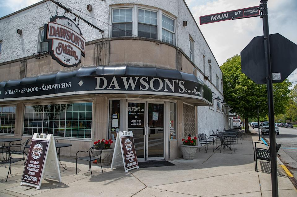 """Dawson's on Main sits empty amid the coronavirus pandemic in Speedway, Ind., on Thursday, May 14, 2020. """"It's a huge hit for everyone, it's kind of our Super Bowl,"""" said owner Chris Hill about not having the Indianapolis 500 in May. """"It affects everything in Speedway. Hopefully we'll have it in August but it's kind of a moving target right now. That's the biggest frustration, it's the big unknown."""""""