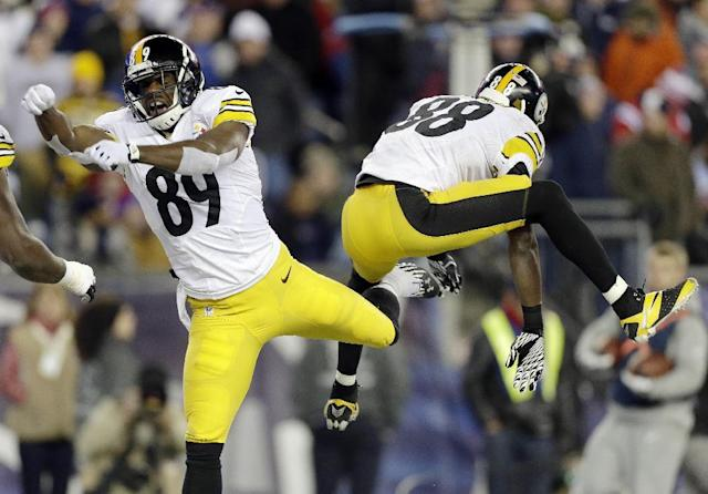 Pittsburgh Steelers wide receiver Jerricho Cotchery (89) celebrates his touchdown catch with Matthew Mulligan, right, in the third quarter of an NFL football game against the New England Patriots, Sunday, Nov. 3, 2013, in Foxborough, Mass. (AP Photo/Steven Senne)