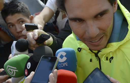 Spanish tennis player Rafael Nadal talks with the media in front of the hospital after successfully undergoing an operation to remove his appendix in Barcelona, Spain, Wednesday, Nov 5, 2014. A month ago, the tennis star tried to play through suspected appendicitis at the Shanghai Masters but acknowledged experiencing discomfort and was ousted in the second round by fellow Spaniard Feliciano Lopez. Nadal tried to treat his appendix with antibiotics before opting for an appendectomy. Nadal's appendix was removed on Monday using laparoscopy or key-hole surgery, a statement said. (AP Photo/Manu Fernandez)