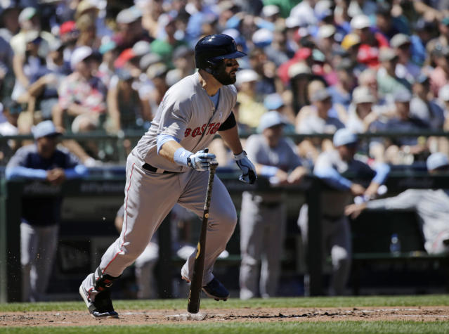 Boston Red Sox's Mitch Moreland hits a two-RBI single against the Seattle Mariners during the third inning of a baseball game, Sunday, June 17, 2018, in Seattle. (AP Photo/John Froschauer)