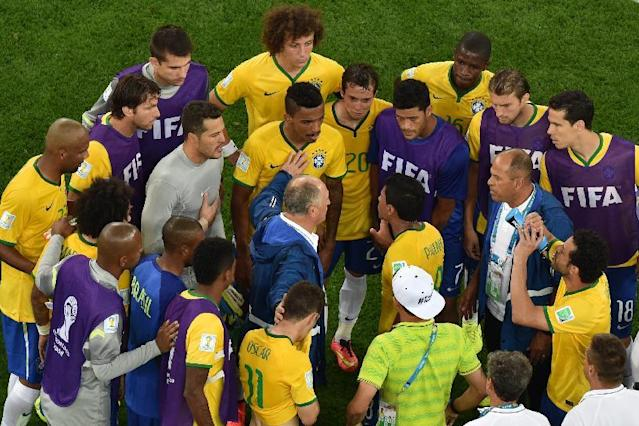 Brazil's coach Luiz Felipe Scolari talks to his players after the World Cup semifinal soccer match between Brazil and Germany at the Mineirao Stadium in Belo Horizonte, Brazil, Tuesday, July 8, 2014. Germany has routed host Brazil 7-1 and advanced to the final of the World Cup. (AP Photo/Felipe Dana, Pool)
