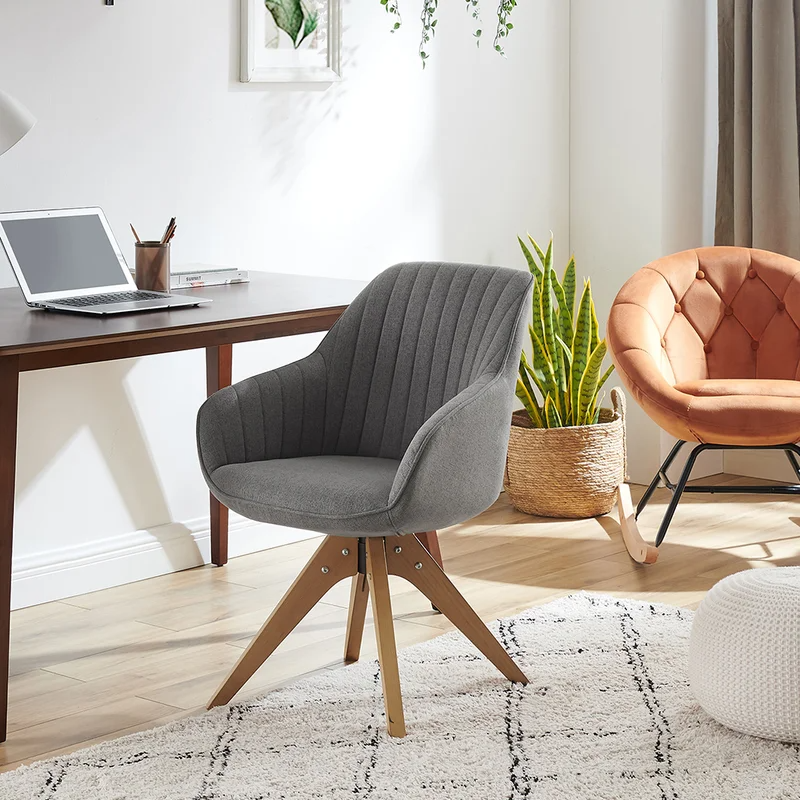 """<h2>Corrigan Studio Brister Swivel Side Chair</h2><br><strong>Best For: Anti-Wheelers</strong><br>Not all desk chairs come tricked out with wheels. If you're looking for a stationary piece that will blend from office to living room, then this incognito swivel style is here to support you. <br><br><strong>The Hype: </strong>4.6 out of 5 stars and 588 reviews on <a href=""""https://www.wayfair.com/furniture/pdp/corrigan-studio-brister-2283-wide-swivel-armchair-w005405263.html"""" rel=""""nofollow noopener"""" target=""""_blank"""" data-ylk=""""slk:Wayfair"""" class=""""link rapid-noclick-resp"""">Wayfair</a><br><br><strong>Comfy Butts Say:</strong> """"Now that I'm working from home full time, I needed a chair that provided me with better back support. I'm so glad I did! It provides me with the back support that I need. I also like the fact that it swivels. I'm 5'9 female and found the chair comfortable, too.""""<br><br><strong>Corrigan Studio</strong> Brister Tufted Swivel Chair, $, available at <a href=""""https://go.skimresources.com/?id=30283X879131&url=https%3A%2F%2Fwww.wayfair.com%2Ffurniture%2Fpdp%2Fcorrigan-studio-brister-2283-wide-swivel-armchair-w005405263.html"""" rel=""""nofollow noopener"""" target=""""_blank"""" data-ylk=""""slk:Wayfair"""" class=""""link rapid-noclick-resp"""">Wayfair</a>"""
