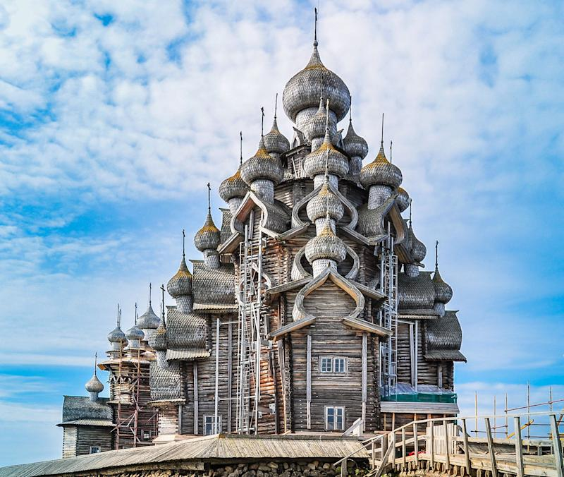 """Built in the early 18th century, Russia'sChurch of the Transfigurationfeatures an octagonal spruce and pine log framework with 22 domes covered with birch bark.Construction of the wooden structure began in 1714, and it is said to have been <a href=""""http://www.slate.com/blogs/atlas_obscura/2014/04/28/the_intricate_wooden_churches_of_kizhi_island.html"""" target=""""_blank"""">built without a single nail</a>."""