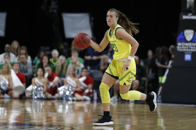 FILE - In this March 6, 2020, file photo, Oregon's Sabrina Ionescu (20) plays against Utah in an NCAA college basketball game in the quarterfinal round of the Pac-12 women's tournament in Las Vegas. Ionescu was named to The Associated Press women's All-America first team Thursday, March 19, 2020. Ionescu is the eighth player in women's basketball history to earn AP All-America honors three times. (AP Photo/John Locher, File)