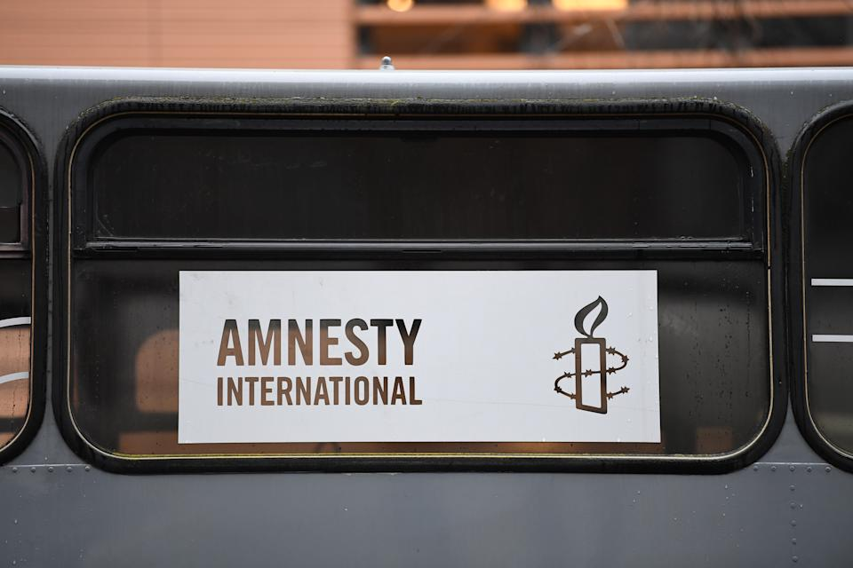 Berlin, Germany - February 17, 2017: Amnesty International sign. It is a non-governmental organisation focused on human rights that claims to have over 7 million members and supporters worldwide