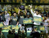 Baylor players celebrate their Big 12 championship which they won against West Virginia after their NCAA college basketball game against Texas Tech Sunday, March 7, 2021, in Waco, Texas. (AP Photo/Jerry Larson)