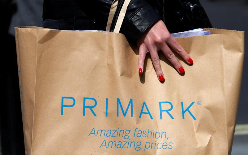 A shopper walks past a branch of clothing retailer Primark in London. Photo: Suzanne Plunkett/Reuters
