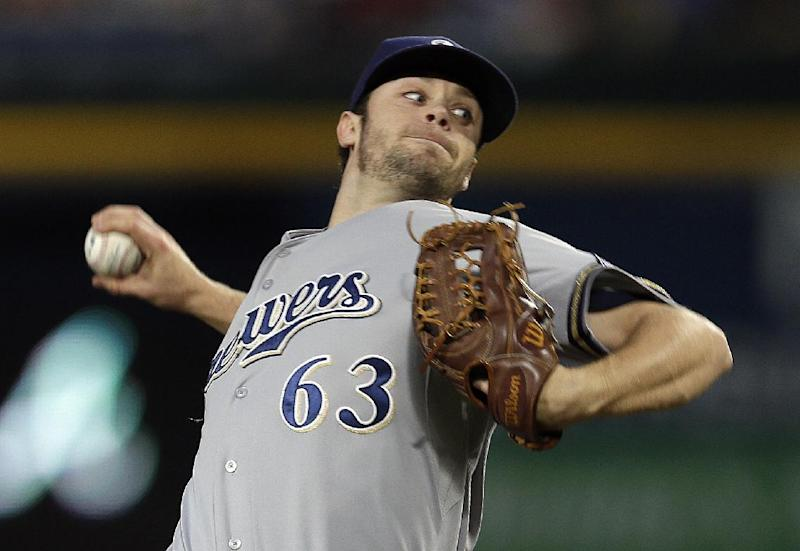 Milwaukee Brewers relief pitcher Tyler Thornburg works in the first inning of a baseball game against the Atlanta Braves on Tuesday, Sept. 24, 2013, in Atlanta. (AP Photo/John Bazemore)