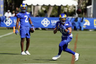 Los Angeles Rams wide receiver Cooper Kupp, right, makes a catch in front of wide receiver Robert Woods (2) during practice at the NFL football team's training camp Wednesday, July 28, 2021, in Irvine, Calif. (AP Photo/Marcio Jose Sanchez)