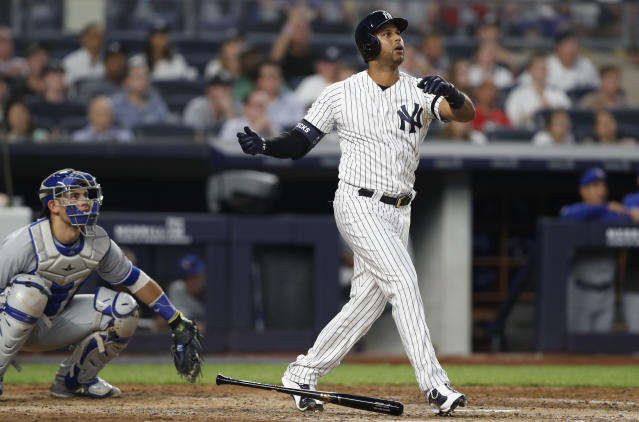 Toronto Blue Jays catcher Luke Maile, left, watches from behind the plate as New York Yankees' Aaron Hicks reacts after hitting a three-run home run during the fifth inning of a baseball game, Monday, June 24, 2019, in New York. (AP Photo/Kathy Willens)