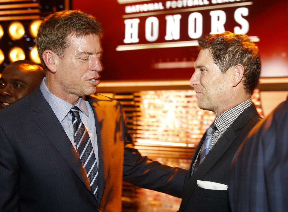 Former NFL players Troy Aikman, left, and Steve Young are seen backstage at the 4th annual NFL Honors at the Phoenix Convention Center Symphony Hall on Saturday, Jan. 1, 2015. (Photo by Colin Young-Wolff/Invision for NFL/AP Images)