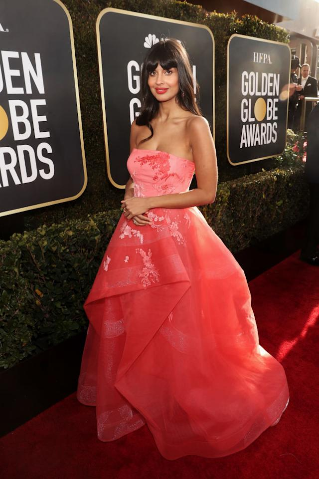 "<em>The Good Place</em> actress Jameela Jamil rocks a pretty coral look. Although you can't see it, Jamil wore jeans underneath her dress, because, as she said, it was ""<a rel=""nofollow"" href=""https://twitter.com/jameelajamil/status/1082035899523723264"">forking cold</a>."" (Photo: Getty Images)"