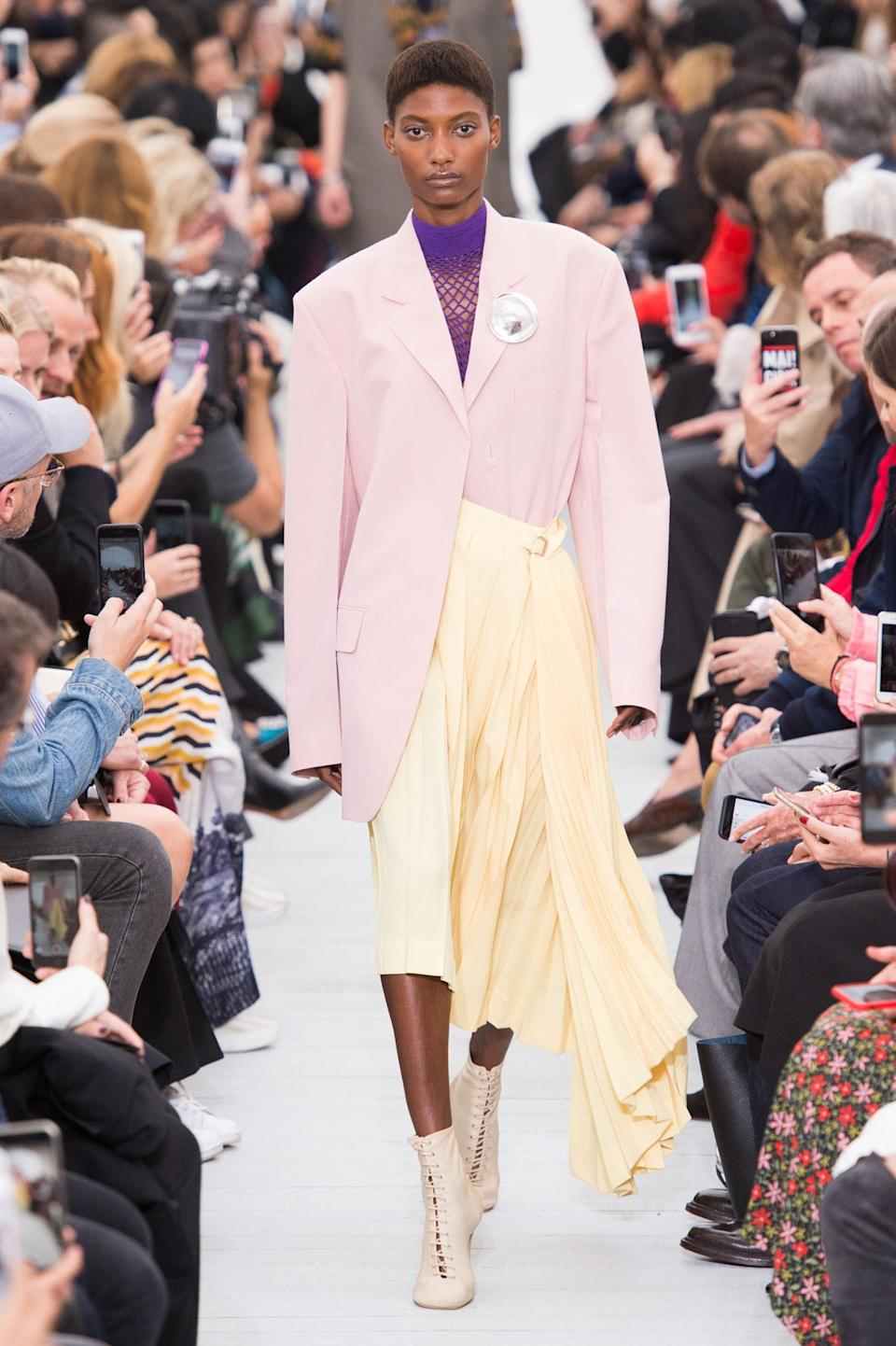 <p>Pastel pink blazer and yellow skirt from the SS18 Céline collection. (Photo: ImaxTree) </p>