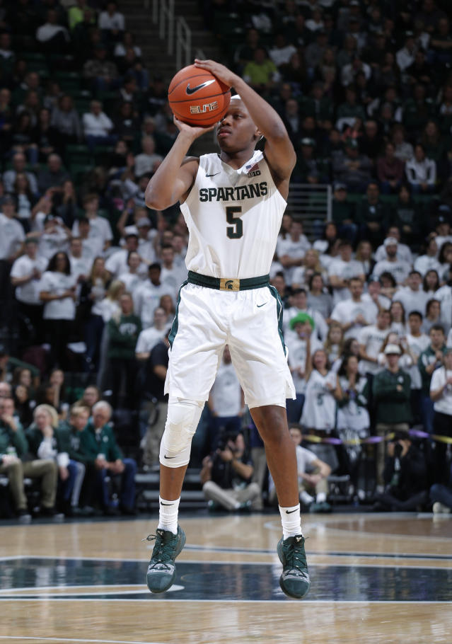 Michigan State's Cassius Winston shoots a 3-pointer against Binghamton during the first half of an NCAA college basketball game Sunday, Nov. 10, 2019, in East Lansing, Mich. (AP Photo/Al Goldis)