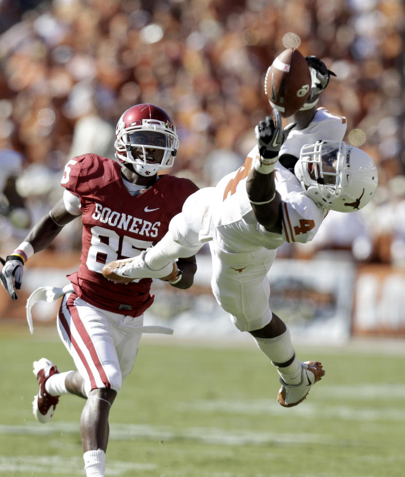 FILE - In this Oct. 2, 2010 file photo, Texas cornerback Aaron Williams (4) reaches for a pass in front of wide receiver Oklahoma Ryan Broyles (85) during the first half of an NCAA football game at the Cotton Bowl in Dallas,. Williams is a top prospect in the upcoming NFL Draft. (AP Photo/LM Otero, File)