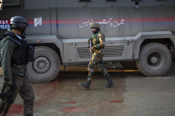 Indian soldiers patrol at the site of an attack on the outskirts of Srinagar, Indian controlled Kashmir, Thursday, Nov. 26, 2020. Anti-India rebels in Indian-controlled Kashmir Thursday killed two soldiers in an attack in the disputed region's main city, the Indian army said.(AP Photo/Mukhtar Khan)