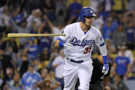 Los Angeles Dodgers' Cody Bellinger tosses his bat as he runs to first after hitting a solo home run during the eighth inning of the team's baseball game against the Tampa Bay Rays on Wednesday, Sept. 18, 2019, in Los Angeles. (AP Photo/Mark J. Terrill)